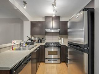 """Photo 1: 409 9319 UNIVERSITY Crescent in Burnaby: Simon Fraser Univer. Condo for sale in """"HARMONY AT THE HIGHLANDS"""" (Burnaby North)  : MLS®# R2244427"""