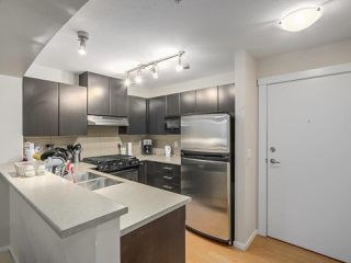 """Photo 2: 409 9319 UNIVERSITY Crescent in Burnaby: Simon Fraser Univer. Condo for sale in """"HARMONY AT THE HIGHLANDS"""" (Burnaby North)  : MLS®# R2244427"""