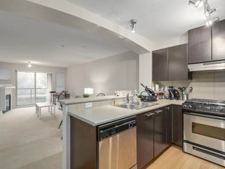 """Photo 4: 409 9319 UNIVERSITY Crescent in Burnaby: Simon Fraser Univer. Condo for sale in """"HARMONY AT THE HIGHLANDS"""" (Burnaby North)  : MLS®# R2244427"""