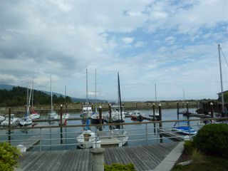 "Photo 1:  in Sechelt: Sechelt District Townhouse for sale in ""PORT STALASHEN"" (Sunshine Coast)  : MLS®# R2300426"