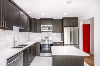 "Photo 1: 101 33412 TESSARO Crescent in Abbotsford: Central Abbotsford Condo for sale in ""Tessaro Villa"" : MLS®# R2334643"