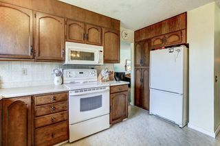 Photo 10: 328 SILVERGROVE Place in Calgary: Silver Springs Detached for sale