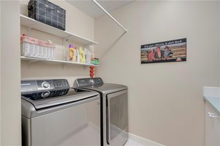 Photo 15: 66 GLENMORE Green SW in Calgary: Kelvin Grove Semi Detached for sale : MLS®# A1029652