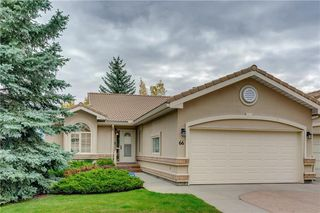Photo 1: 66 GLENMORE Green SW in Calgary: Kelvin Grove Semi Detached for sale : MLS®# A1029652