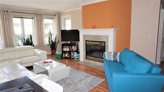 Photo 4: 202 12125 75A Avenue in Surrey: West Newton Condo for sale : MLS®# R2495584