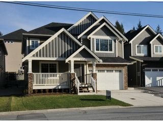 "Photo 1: 7776 TAULBUT Street in Mission: Mission BC House for sale in ""Centennial Park"" : MLS®# F1326641"