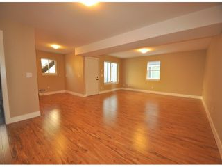 "Photo 13: 7776 TAULBUT Street in Mission: Mission BC House for sale in ""Centennial Park"" : MLS®# F1326641"
