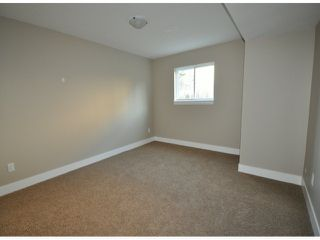 "Photo 14: 7776 TAULBUT Street in Mission: Mission BC House for sale in ""Centennial Park"" : MLS®# F1326641"