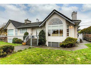 Photo 1: 4683 DARWIN Avenue in Burnaby: Burnaby Hospital House 1/2 Duplex for sale (Burnaby South)  : MLS®# V1103438