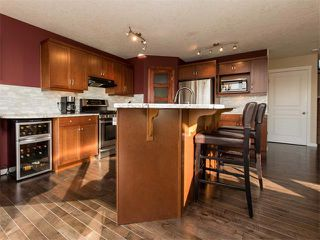 Photo 9: 122 COUGARSTONE Close SW in Calgary: Cougar Ridge House for sale : MLS®# C4010955