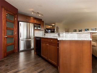 Photo 10: 122 COUGARSTONE Close SW in Calgary: Cougar Ridge House for sale : MLS®# C4010955