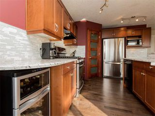 Photo 11: 122 COUGARSTONE Close SW in Calgary: Cougar Ridge House for sale : MLS®# C4010955