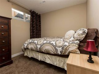 Photo 29: 122 COUGARSTONE Close SW in Calgary: Cougar Ridge House for sale : MLS®# C4010955