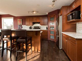Photo 8: 122 COUGARSTONE Close SW in Calgary: Cougar Ridge House for sale : MLS®# C4010955