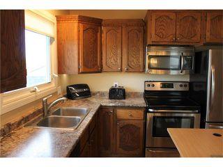 Photo 14: 121 CARR Crescent: Okotoks House for sale : MLS®# C4081929