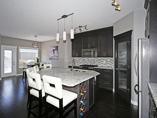 Photo 7: 112 KINGSBRIDGE Way SE: Airdrie House for sale : MLS®# C4124899