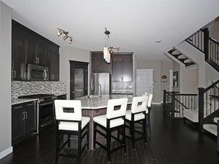 Photo 4: 112 KINGSBRIDGE Way SE: Airdrie House for sale : MLS®# C4124899
