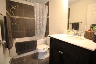 """Photo 11: 18610 65 Avenue in Surrey: Cloverdale BC Townhouse for sale in """"Ridgeway"""" (Cloverdale)  : MLS®# R2299055"""
