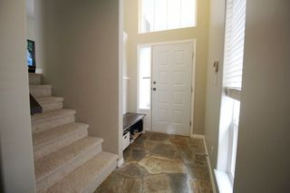 """Photo 2: 18610 65 Avenue in Surrey: Cloverdale BC Townhouse for sale in """"Ridgeway"""" (Cloverdale)  : MLS®# R2299055"""
