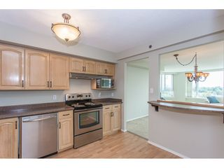 "Photo 6: 1405 3170 GLADWIN Road in Abbotsford: Central Abbotsford Condo for sale in ""Regency Tower"" : MLS®# R2318450"