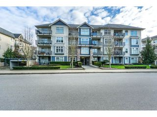 "Photo 1: 407 8084 120A Street in Langley: Queen Mary Park Surrey Condo for sale in ""Eclipse"" (Surrey)  : MLS®# R2333868"