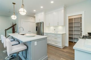 """Photo 3: 101 8217 204B Street in Langley: Willoughby Heights Townhouse for sale in """"IRONWOOD PARK"""" : MLS®# R2339959"""
