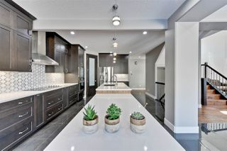 Photo 10: 3916 KENNEDY Crescent in Edmonton: Zone 56 House for sale : MLS®# E4146654