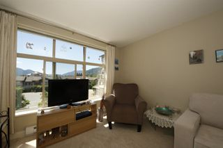 "Photo 6: 318 1211 VILLAGE GREEN Way in Squamish: Downtown SQ Condo for sale in ""ROCKCLIFF AT EAGLEWIND"" : MLS®# R2372303"