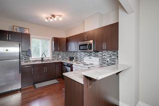 Photo 8: 11944 53 Street in Edmonton: Zone 06 House Half Duplex for sale : MLS®# E4173324
