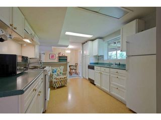 Photo 14: 4379 CAPILANO Road in North Vancouver: Canyon Heights NV House for sale : MLS®# V1061057