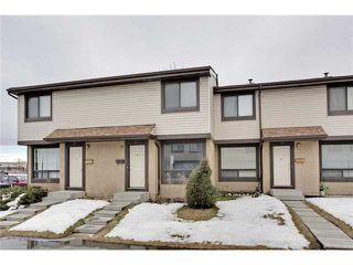 Photo 1: 52 2727 RUNDLESON Road NE in Calgary: Rundle Townhouse for sale : MLS®# C3650032