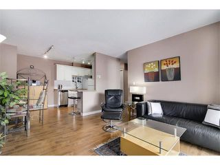 Photo 2: 835 19 AV SW in Calgary: Lower Mount Royal Condo for sale : MLS®# C4032189