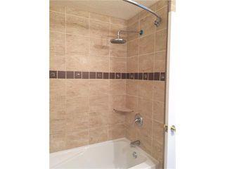 Photo 11: 745 ABOYNE Way NE in Calgary: Abbeydale House for sale : MLS®# C4072621