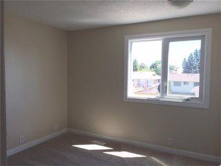 Photo 12: 745 ABOYNE Way NE in Calgary: Abbeydale House for sale : MLS®# C4072621