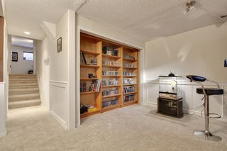 Photo 23: 555 Woodpark Crescent SW in Calgary: House for sale : MLS®# C3650017