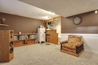 Photo 24: 555 Woodpark Crescent SW in Calgary: House for sale : MLS®# C3650017
