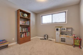Photo 16: 555 Woodpark Crescent SW in Calgary: House for sale : MLS®# C3650017