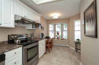 "Photo 12: 4 6537 138 Street in Surrey: East Newton Townhouse for sale in ""Charleston Green"" : MLS®# R2303833"