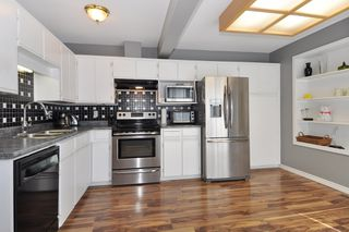 """Photo 8: 21 18951 FORD Road in Pitt Meadows: Central Meadows Townhouse for sale in """"PINE MEADOWS"""" : MLS®# R2346745"""