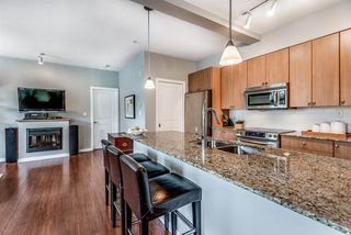 """Photo 8: 107 290 FRANCIS Way in New Westminster: Fraserview NW Condo for sale in """"The Grove"""" : MLS®# R2372872"""