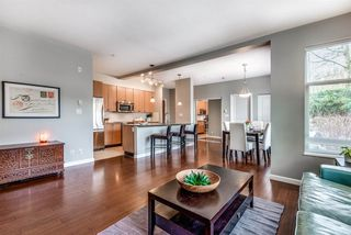 """Photo 1: 107 290 FRANCIS Way in New Westminster: Fraserview NW Condo for sale in """"The Grove"""" : MLS®# R2372872"""