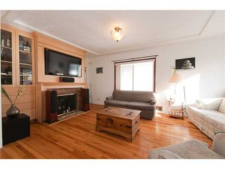 "Photo 2: 4689 GOTHARD Street in Vancouver: Collingwood VE House for sale in ""COLLINGWOOD"" (Vancouver East)  : MLS®# V872513"