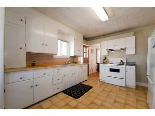 "Photo 4: 4689 GOTHARD Street in Vancouver: Collingwood VE House for sale in ""COLLINGWOOD"" (Vancouver East)  : MLS®# V872513"