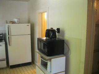 Photo 3: 672 MCPHILLIPS Street in WINNIPEG: Maples / Tyndall Park Residential for sale (North West Winnipeg)  : MLS®# 1111513