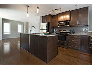 Photo 5: 217 1905 27 Avenue SW in CALGARY: South Calgary Townhouse for sale (Calgary)  : MLS®# C3619773