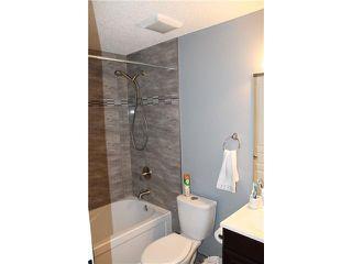Photo 18: 102 AUBURN CREST Way SE in Calgary: Auburn Bay Residential Detached Single Family for sale : MLS®# C3643783