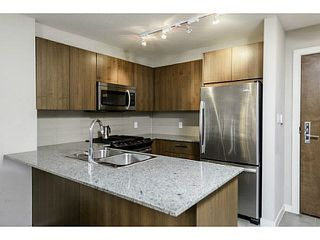 """Photo 7: 107 5885 IRMIN Street in Burnaby: Metrotown Condo for sale in """"MACPHERSON WALK"""" (Burnaby South)  : MLS®# V1133409"""