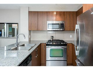 """Photo 6: 107 5885 IRMIN Street in Burnaby: Metrotown Condo for sale in """"MACPHERSON WALK"""" (Burnaby South)  : MLS®# V1133409"""