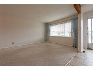 Photo 2: 1203 MACKID Road NE in Calgary: Mayland Heights House for sale : MLS®# C4036738