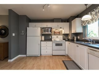 "Photo 11: 211 33718 KING Road in Abbotsford: Poplar Condo for sale in ""College Park"" : MLS®# R2060249"
